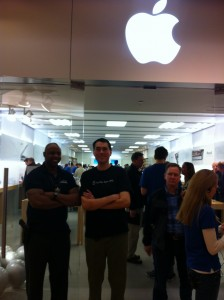 A security guard and Barry watch over the Apple Store